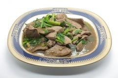 Fígado fritado agitação da carne de porco com aipo Fotografia de Stock