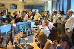 Físicos na sala de comando da experiência foto de stock royalty free