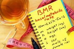 Fórmula básica de la tasa metabólica de BMR en una libreta fotos de archivo libres de regalías