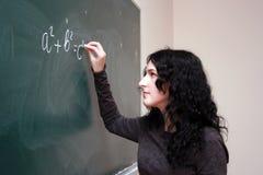 Fórmula de la escritura de la muchacha fotografía de archivo