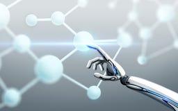 Fórmula de molécula conmovedora de la mano del robot Imagenes de archivo
