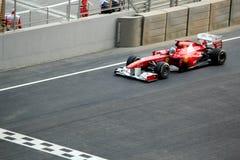 Fórmula 1 Ferrari automotriz que compite con Imágenes de archivo libres de regalías