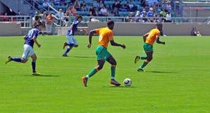 Fósforo de futebol da Costa do Marfim e do Japão Fotografia de Stock Royalty Free