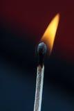 Fósforos ardentes no preto Imagem de Stock