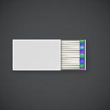 Fósforos coloridos em uma caixa Fotos de Stock