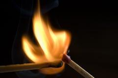 Fósforos no incêndio Foto de Stock Royalty Free