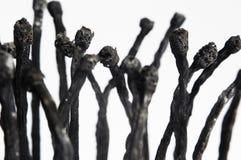 fósforos queimados em um fundo branco Foto de Stock Royalty Free