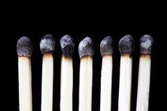 Fósforos queimados, fotografia do conceito imagem de stock