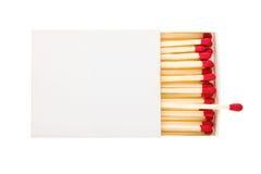 Fósforos vermelhos em uma caixa branca foto de stock royalty free