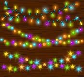Födelsedagar för nya år för berömjul och andra för ljuskulor för händelser glödande färgrika ledde girlander för lampor royaltyfri illustrationer