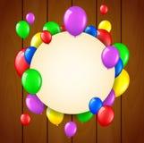 Födelsedagbakgrund med flygballonger och ställe för text på träbakgrund Royaltyfria Bilder