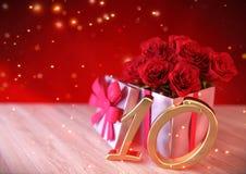 Födelsedagbegrepp med röda rosor i gåva på träskrivbordet tionde 10th 3d framför Arkivbilder