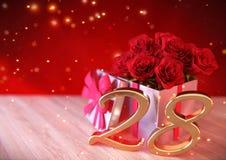 Födelsedagbegrepp med röda rosor i gåvan på träskrivbordet tjugo-åttondel 28th 3d framför Fotografering för Bildbyråer