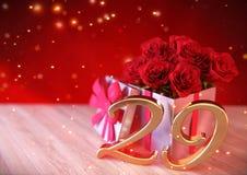 Födelsedagbegrepp med röda rosor i gåvan på träskrivbordet twenty-nineth 29th 3d framför Royaltyfri Bild