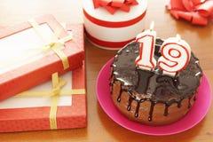Födelsedagberöm på nitton år royaltyfria foton
