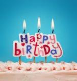 födelsedagen undersöker lyckligt Arkivbild