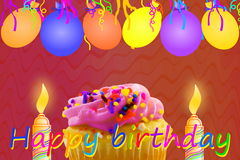 Födelsedaghälsningkort med muffinballongremsan och stearinljus Royaltyfria Foton