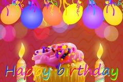 Födelsedaghälsningkort med muffinballongremsan och stearinljus Arkivfoto