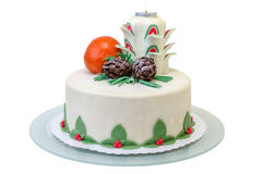 Födelsedagkaka med en stearinljus, en apelsin och en gran två Royaltyfria Bilder