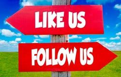Följ oss och gilla oss Arkivbild