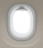 Fönster av flygplanet som isoleras med den snabba banan Arkivbild