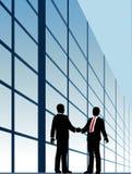 fönster för förhållande för byggnadsaffärshandskakning Arkivfoto