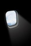 fönster för ljus stråle för flygplan Royaltyfri Foto