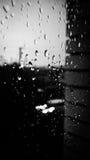 Fönster i regnet Arkivfoto