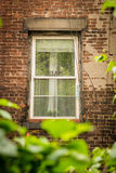 Fönster i tegelstenbyggnad med det DRÖM- tecknet Fotografering för Bildbyråer