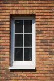 Fönster i tegelstenväggen Fotografering för Bildbyråer