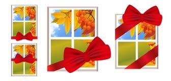 Fönster med det röda bandet och pilbåge som en gåva med en landskaphöst Royaltyfria Bilder