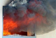 Fönster på brand Arkivbilder