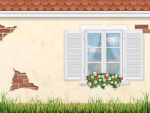 Fönster på den gamla väggen Arkivbild