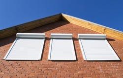 Fönster på en vägg Arkivfoton
