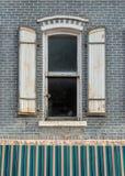Fönstret med stänger med fönsterluckor Royaltyfri Bild