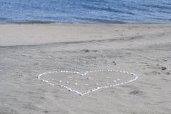 Förälskelse, hav och sand Royaltyfria Foton