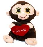 Förälskelse mjuka Toy Baby Monkey på vit bakgrund Arkivfoto