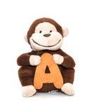 Förälskelse mjuka Toy Baby Monkey på vit bakgrund Arkivbilder