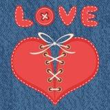 Förälskelse och hjärta med jeansbakgrund Arkivbilder