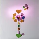 Förälskelse och hjärtor för valentindag Arkivfoto