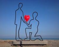 Förälskelse på en strand Arkivfoto