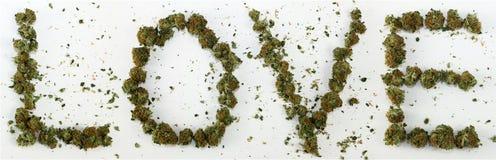 Förälskelse som stavas med marijuana Royaltyfri Foto