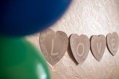 Förälskelsebokstäver på väggen Arkivfoton