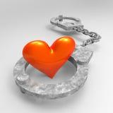 Förälskelsehjärta i handbojor Arkivbilder