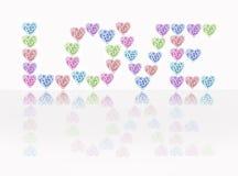 Förälskelsehjärtor och blommor Arkivfoton