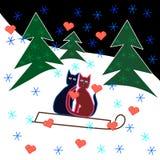 Förälskelsekatter åka släde ritt till och med den snöig backen Royaltyfria Bilder
