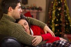 Förälskelsepar på julnatten Arkivbild