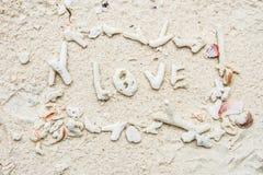 Förälskelsetecken på stranden Royaltyfri Bild