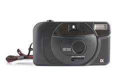 Föråldrad amatörmässig kompakt kamera som isoleras på den vita bakgrunden med den snabba banan royaltyfri foto