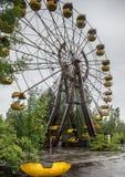Föråldrade ferris rullar Pripyat parkerar in Fotografering för Bildbyråer